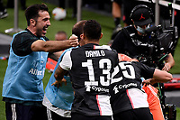 Adrien Rabiot of Juventus celebrates with team mates Danilo , Gianluigi Buffon after scoring the goal of 0-1 during the Serie A football match between AC Milan and Juventus FC at stadio San Siro in Milan ( Italy ), July 7th, 2020. Play resumes behind closed doors following the outbreak of the coronavirus disease. <br /> Photo Federico Tardito / Insidefoto