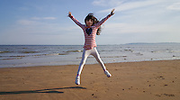 Pictured: Seven year old Sophie Rhian jumping about in Swansea Bay in the early evening of Saturday 07 May 2016<br /> Re: Sunshine and high temperatures have been forecast for most of the UK.