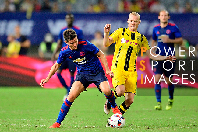 Manchester United midfielder Ander Herrera (l) fights for the ball with Borussia Dortmund midfielder Sebastian Rode (r) during an attack of Manchester United during the International Champions Cup China 2016, match between Manchester United vs Borussia  Dortmund on 22 July 2016 held at the Shanghai Stadium in Shanghai, China. Photo by Marcio Machado / Power Sport Images