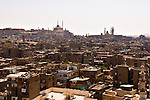 Cairo, Egypt -- View from the minarets of the Bab Zuwayla gate.  One of the three first gates installed around the historic walled city of Cairo, standing at the southern boundary of old Fatimid Cairo.  The two minarets atop this tower actually belong to the nearby Mosque of al-Mu'ayyad, which sits just inside this gate.  For a small fee, it is possible to climb the minarets for a spectacular view of old and new Cairo.  The Citadel of Saladin (on the left) and the Mosque and madrassa of Sultan Hassan (on the right) dominate the skyline of the city in this direction. © Rick Collier / RickCollier.com