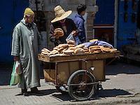 Essaouira, Morocco.  Bread Vendor, Avenue Mohammed Zerktouni.