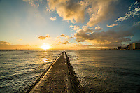 A visitor stands at the very end of a jetty in Waikiki, East O'ahu.
