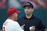 Umpire Olindo Mattia listens to North Carolina State Wolfpack head coach Elliott Avent (9) during the game against the Louisville Cardinals at Doak Field at Dail Park on March 24, 2017 in Raleigh, North Carolina. The Wolfpack defeated the Cardinals 3-1. (Brian Westerholt/Four Seam Images)