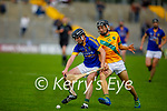 Both Tom Foley of Lixnaw and Ronan Walsh of Kilmoyley keep their eye on the sliotar as they tussle for possession in round 2 of the County Senior hurling championship