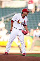 Richard Castillo (12) of the Springfield Cardinals stands on the mound during a game against the Northwest Arkansas Naturals at Hammons Field on June 14, 2012 in Springfield, Missouri. (David Welker/Four Seam Images)