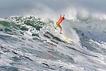 Surfer Shane Desmond rides a wave threw the brake in the semi finals of Mavericks  contest near Half Moon Bay, California.