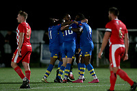 L'heureux Menga of Romford scores the first goal for his team and celebrates with his team mates during Romford vs Tilbury, Pitching In Isthmian League North Division Football at Mayesbrook Park on 29th September 2021