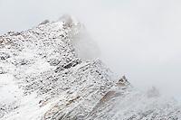 Wetterhorn Peak (14,015 feet) engulfed in clouds.