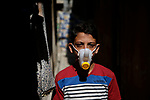A Palestinian child wears the top of a water canister as a face mask 14 september 2020. Photo by Osama Baba