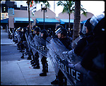 November 18, 2003 -- Miami, Florida. Cops Patrol the downtown area of Miami on Biscayne Blvd.   The FTAA talks are being held at the Inter-Continental Hotel in Miami November 17-21. The proposed talks could create the biggest trade zone in the Western Hemisphere with 34 Latin and Caribbean Nations, excluding Cuba.
