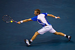 BANGKOK, THAILAND - OCTOBER 02:   Jarkko Nieminen of Finland returns a ball to Benjamin Becker of Germany during the Day 8 of the PTT Thailand Open at Impact Arena on October 2, 2010 in Bangkok, Thailand. Photo by Victor Fraile / The Power of Sport Images