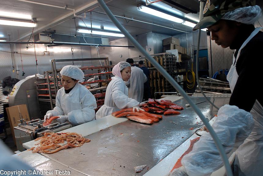 USA. Brooklyn. 2006...Workers prepare smoked Salmon at Banner Smoked Fish Inc in Coney Island, Brooklyn..©Andrew Testa