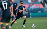 DENVER, CO - JUNE 3: Antonee Robinson #5 of the United States moves with the ball during a game between Honduras and USMNT at EMPOWER FIELD AT MILE HIGH on June 3, 2021 in Denver, Colorado.