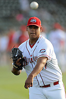 Pitcher Dedgar Jimenez (47) of the Greenville Drive warms up before a game against the Charleston RiverDogs on Sunday, May 24, 2015, at Fluor Field at the West End in Greenville, South Carolina. Charleston won 3-2. (Tom Priddy/Four Seam Images)