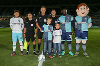 Captains, mascots, match officials and Bodger line up ahead of the The Checkatrade Trophy match between Wycombe Wanderers and West Ham United U21 at Adams Park, High Wycombe, England on 4 October 2016. Photo by David Horn.