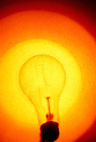 Lightbulb with warm grainy background