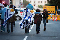 Uruguay fans, including one dressed as a duck, walk the Cape Town fan walk before the 2010 FIFA World Cup semi-final between the Netherlands and Uruguay at Greenpoint Stadium in Cape Town, South Africa on Tuesday, July 6, 2010.  Netherlands defeated Uruguay 3-2.