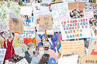 """A crowd gathers in Boston Common for the 2020 Women's March protest in opposition to the re-election of US president Donald Trump in Boston, Massachusetts, on Sat., Oct. 17, 2020.<br /> The signs here read """"I'm 9 and I get it. These men should go back to basics,"""" """"Act like a lady and smash the patriarchy,"""" """"Fight like a girl"""" (featuring an image of Supreme Court Justice Ruth Bader Ginsburg), """"Make Margaret Atwood Fiction Again,"""" """"Women's rights are an essential part of the overall human rights agenda - RBG,"""" and """"Abort this presidency in its first term."""""""