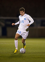 Rob Lovejoy (16) of North Carolina brings the ball upfield during the game at the Maryland SoccerPlex in Germantown, MD. North Carolina defeated Virginia on penalty kicks after playing to a 0-0 tie in regulation time.  With the win the Tarheels advanced to the finals of the ACC men's soccer tournament.