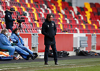 14th February 2021; Brentford Community Stadium, London, England; English Football League Championship Football, Brentford FC versus Barnsley; Brentford Manager Thomas Frank looks on from the touchline