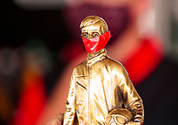 """Jul 12, 2020; Clermont, Indiana, USA; Detailed view of a tape """"mask"""" on the NHRA Wally trophy won by top fuel driver Billy Torrence after winning the E3 Spark Plugs Nationals at Lucas Oil Raceway. This is the first race back for NHRA since the start of the COVID-19 global pandemic. Mandatory Credit: Mark J. Rebilas-USA TODAY Sports"""