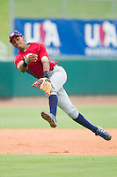 Shortstop Francisco Lindor #12 makes an off-balance throw to first base during infield practice during the USA Baseball 18U National Team Trials at the USA Baseball National Training Center on June 30, 2010, in Cary, North Carolina.  Photo by Brian Westerholt / Four Seam Images