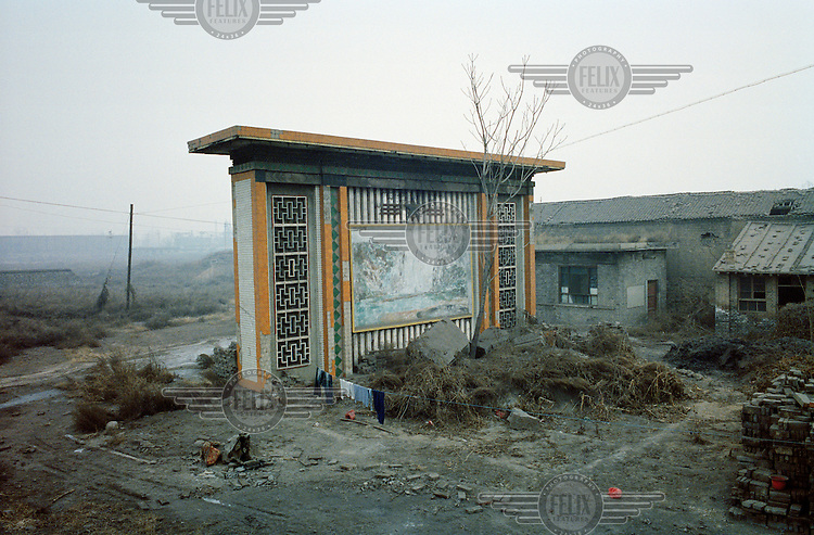 A mural painting depicting a famous Chinese waterfall stands in a village covered in fly ash and dust from the emissions produced by nearby coal coking plants and tar refineries. Linfen, which has extremely high levels of air pollution, is known as one of the most polluted cities in China.