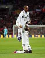 Pictured: Nathan Dyer of Swansea (on the ground) is celebrating his goal with team mate Wayne Routledge who is jumping over him. Sunday 24 February 2013<br /> Re: Capital One Cup football final, Swansea v Bradford at the Wembley Stadium in London.