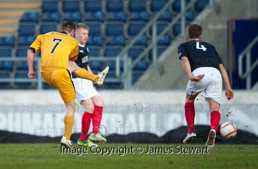 Dumbarton's Dumbarton's Mark Gilhaney  scores their first goal.