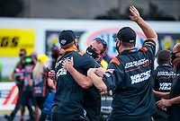 Aug 9, 2020; Clermont, Indiana, USA; Andrew Hines (left) and crew members for NHRA pro stock motorcycle rider Angelle Sampey celebrate after winning the Indy Nationals at Lucas Oil Raceway. Mandatory Credit: Mark J. Rebilas-USA TODAY Sports