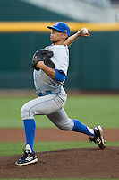 UCLA pitcher Nick Vander Tuig (21) delivers a pitch to the plate against the North Carolina State Wolfpack during Game 8 of the 2013 Men's College World Series on June 18, 2013 at TD Ameritrade Park in Omaha, Nebraska. The Bruins defeated the Wolfpack 2-1, eliminating North Carolina State from the tournament. (Andrew Woolley/Four Seam Images)