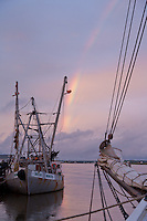 Commercial Fishing Trawler with Rainbow at Sunset