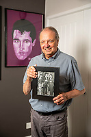 BNPS.co.uk (01202 558833)<br /> Pic: MaxWillcock/BNPS<br /> <br /> Pictured: Todd Slaughter with a picture of Radio Luxembourg DJ Tony (left), Elvis Presley (centre) and himself (right), during the first occasion Todd met Elvis in Las Vegas, USA, in 1972.<br /> <br /> One of the world's most renowned Elvis Presley fan clubs is expected to sell for a staggering £100,000.<br /> <br /> The Official Elvis Presley Fan Club of Great Britain was established in London in 1957 and has a membership of almost 5,000 people over 60 years on.<br /> <br /> The current president, Todd Slaughter, bought it in 1967 after working as a journalist on music magazines.