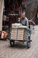 Marrakesh, Morocco.  Egg Man Delivering Eggs in the Medina.