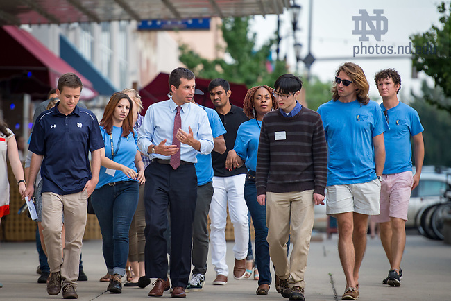 August 15, 2017; South Bend mayor Pete Buttigieg chats with graduates students during graduate student orientation events in downtown South Bend. (Photo by Matt Cashore/University of Notre Dame)