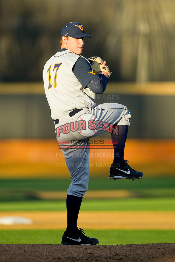 West Virginia Mountaineers relief pitcher Marshall Thompson (17) in action against the Wake Forest Demon Deacons at Wake Forest Baseball Park on February 24, 2013 in Winston-Salem, North Carolina.  The Demon Deacons defeated the Mountaineers 11-3.  (Brian Westerholt/Four Seam Images)