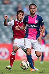 Jorge Tarres of Kitchee (R) being followed by Kin Pong Kwok of SCAA (L) during the HKFA Premier League between South China Athletic Association vs Kitchee at the Hong Kong Stadium on 23 November 2014 in Hong Kong, China. Photo by Aitor Alcalde / Power Sport Images