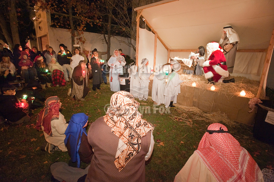 Santa Claus, angels, wise men, and pilgrims pay respect to the Christ child in the manger at a live Nativity during Sutter Creek's Las Posadas