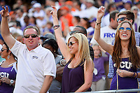 TCU fans cheer for their team during an NCAA football game, Saturday, October 18, 2014 in Fort Worth, Tex. TCU leads Oklahoma State 28-9 at the halftime. (Mo Khursheed/TFV Media via AP Images)