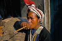 Peasant woman smoking in Rolpa District Nepal