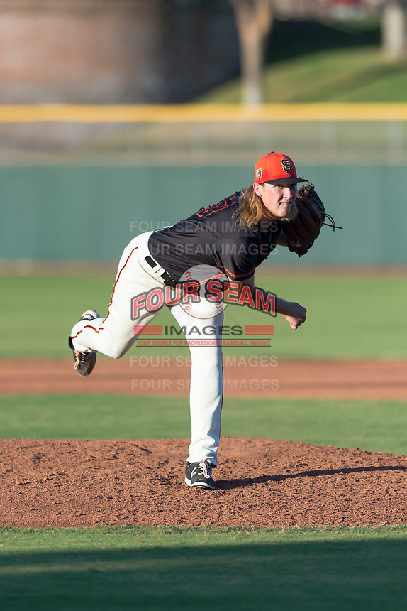 AZL Giants Orange relief pitcher Ben Strahm (13) follows through on his delivery during an Arizona League game against the AZL Rangers at Scottsdale Stadium on August 4, 2018 in Scottsdale, Arizona. The AZL Giants Black defeated the AZL Rangers by a score of 3-2 in the first game of a doubleheader. (Zachary Lucy/Four Seam Images)