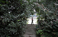 "A man with a mandolin in the ""Living Water Garden"" in Chengdu, Sichuan Province. The garden is a park aimed at highlighting the importance of the relationship between man and water. 2010"
