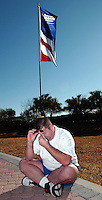 Photo by Rick WIlson--2/1/03--Kyle Garner, a businessman from Portland, Oregon, breaks down with emotion as he sits alone in front of the enterance to the John F. Kennedy Space Center Visitor Complex following the Columbia tragedy. Garner was traveling from Miami, Fl to Chicago, Ill when he felt the urge to visit the space complex to contemplate the Space Shuttle Columbia disaster...