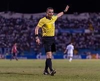 SAN PEDRO SULA, HONDURAS - SEPTEMBER 8: Referee Fernando Gomez makes a call during a game between Honduras and USMNT at Estadio Olímpico Metropolitano on September 8, 2021 in San Pedro Sula, Honduras.
