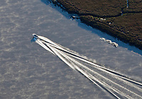 aerial photograph of the wake of a power boat on the Petaluma River, Sonoma county, California