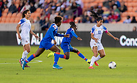 HOUSTON, TX - JANUARY 31: Shirley Cruz #10 of Costa Rica is fouled by Sherly Jeudy #9 of Haiti during a game between Haiti and Costa Rica at BBVA Stadium on January 31, 2020 in Houston, Texas.