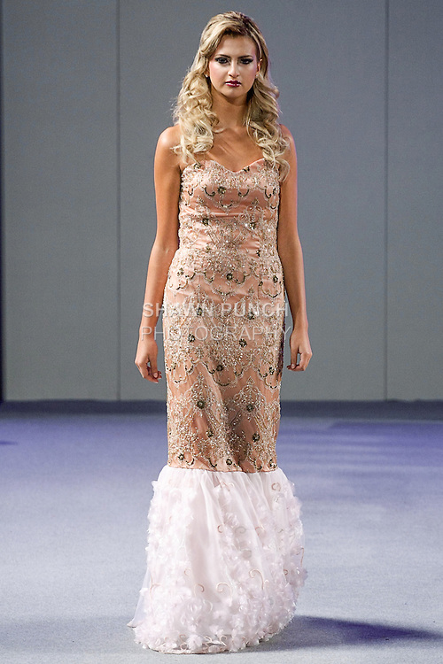 Model walks runway in an outfit from the Andres Aquino Spring 2013 collection, during Couture Fashion Week in New York City, September 15, 2012.