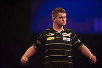 21.12.2014.  London, England.  William Hill World Darts Championship.  Ryan De Vreede [NED] celebrates a winning leg in his match with Dave Chisnall (8) [ENG]. Chisnall won the match 3-0