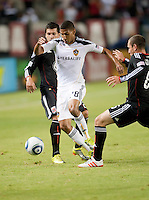 LA Galaxy defender Sean Franklin (28) splits the DC United defense during the first half of the game between LA Galaxy and the D.C. United at the Home Depot Center in Carson, CA, on September 18, 2010. LA Galaxy 2, D.C. United 1.