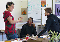 Hearing impaired student and her Support Worker listening to the tutor, Art & Design, Kingston College.